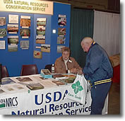 Volunteers help to educate the public on protecting our natural resources.