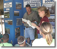 Volunteers conduct hands-on instructions on how to protect our natural resources.