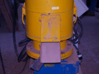 Photo of a pellet mill used to form pellets for stove