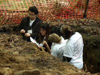 students answer questions at Envirothon soils station