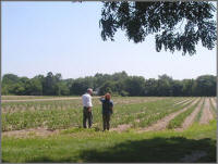 Soil conservationist and land owner assess resource needs at farm.