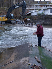 Dunne inspects piece of breached dam