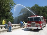 Photo of a dry hydrant being used