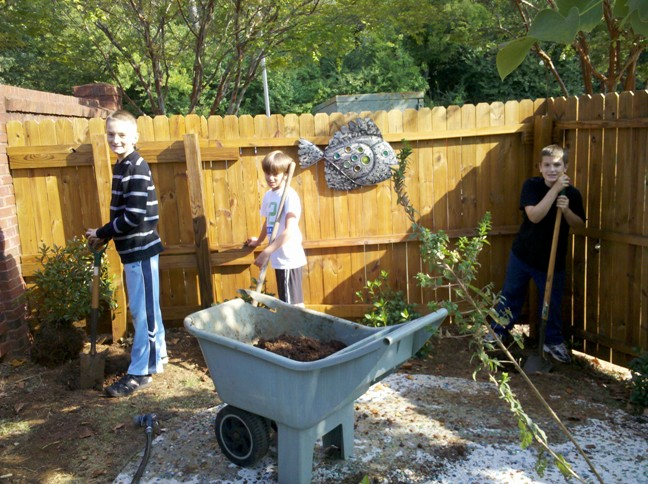 Students help plant gardens.