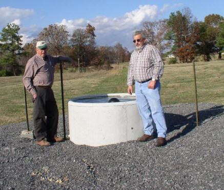 l-r: James Huber and Roy Sanders view heavy use area.