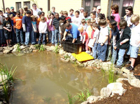 Oxford Elementary Students Stock Fish Pond