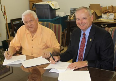 Rolin and Puckett sign agreements