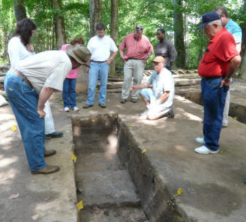 Dr. John Cottier (kneeling) talks to AL NRCS employees about the site.