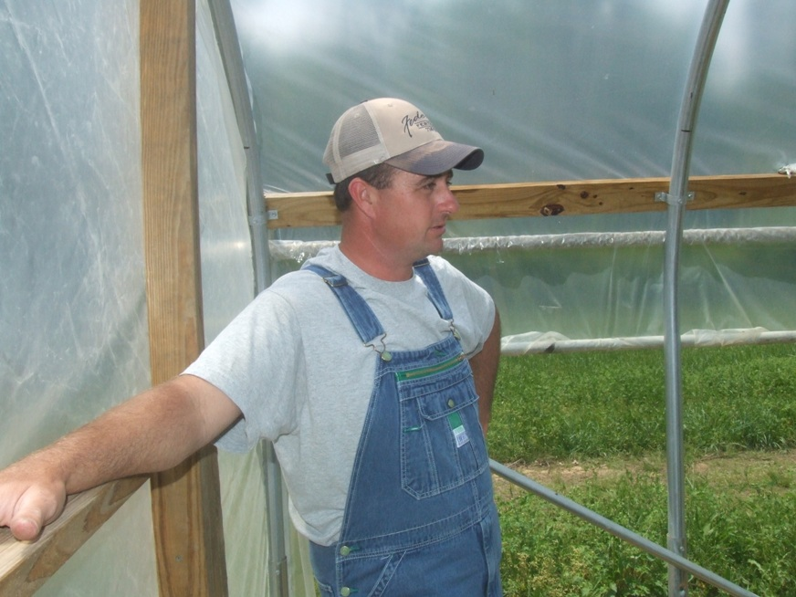 Jeremy Calvert in his hoop house.