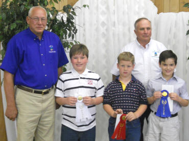 District supervisors present awards to poster contest winners.
