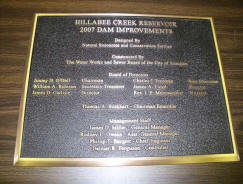 Plaque placed at rehabilitated dam.