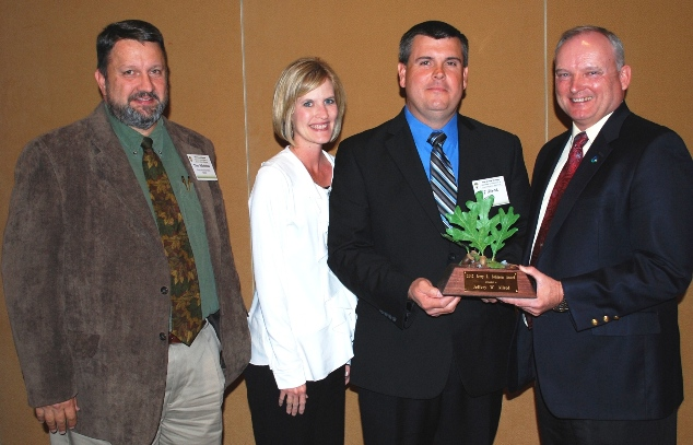 Jeff Allred was recipient of the 2012 Jerry Johnson Award.  (l-r) NRCS State Staff Forester Tim Albritton, Dana and Jeff Allred; and Alabama NRCS State Conservationist Dr. William Puckett