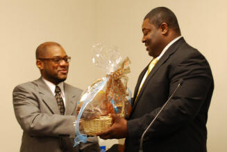 l-r: Wilson receives gift from Dansby for speaking at the meeting.