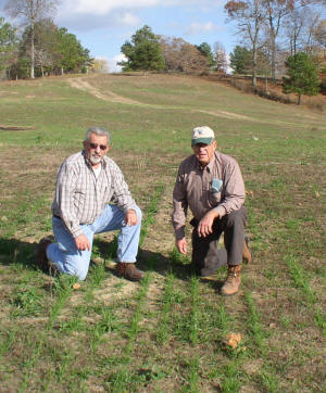 l-r: Roy Sanders and James Huber check out stand of Fescue grass.