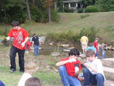 Students testing water from creek