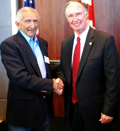 Elder Billy Smith, Poarch Band of Creek Indians, talkes with Robert Bentley, Governor of Alabama.
