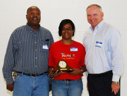 Earl and Charisse Snell Accept Alabama NRCS Small Farmer of the Year from State Conservationist Dr. William Puckett.