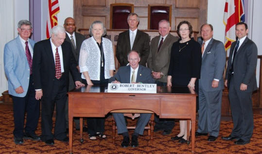 Gov. Bently signs soil proclamation.