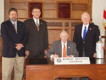 Alabama Governor Bently signs proclamation.