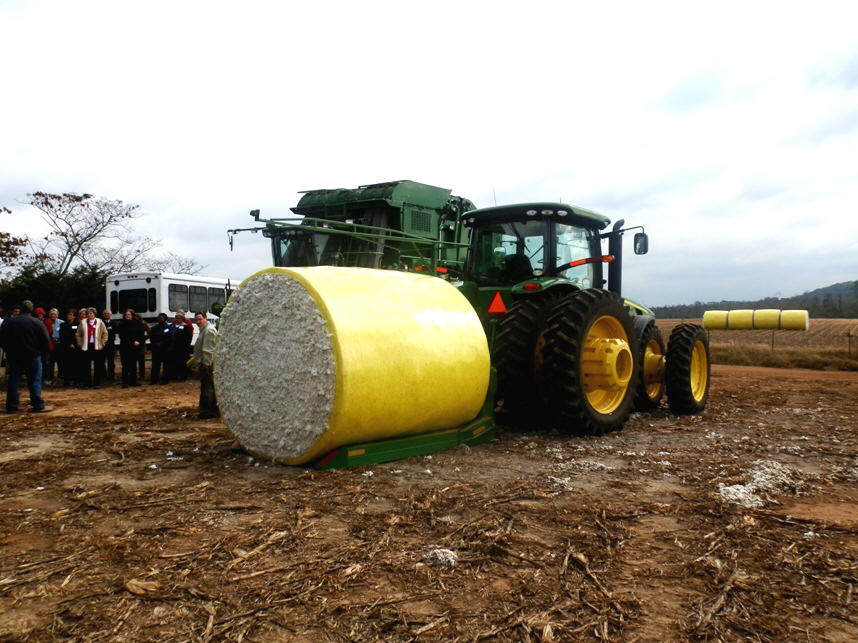 Round cotton baler demonstrated on tour.