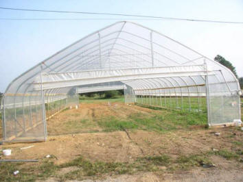 Mr. Turner constructs hoop house.