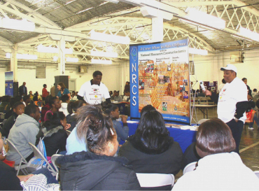 Photo of NRCSers giving a presentation to students.