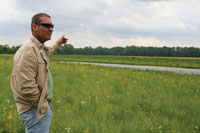 Dave Hiatt looks over a new floodplain easement