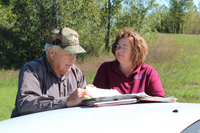 Landowner Farris talks over the conservation plan with Danette Cross