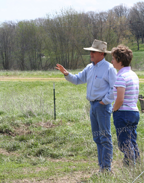 Jill Keeton, District Conservationist talking with local farmer.