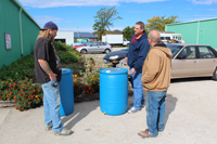 James, Matt and Mike talk over how the rain barrel will be used.