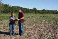 Megan Andrews, Resource Conservationist Kendall County SWCD, and Jason Pettit, Director of Kendall County Forest Preserve District, review restoration plans for the Recovery Act project