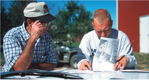 Photo of NRCSer and Landowner working on TSP