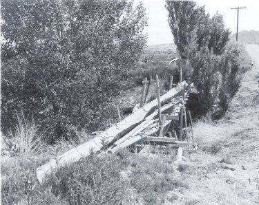 Old half barrel flume which is to be replaced on Willie Behling place in Emery County.