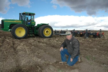 Dryland Farmer Syd Fuhriman checks soil condition while tilling terraces on his farm in Northern Box Elder County