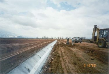Concrete ditch lining improves irrigation efficiency up to 55%. ARDL loans make it economically feasible to reduce water loss by over half.