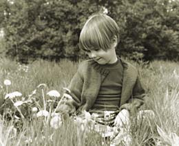 Photograph of girl in field of flowers