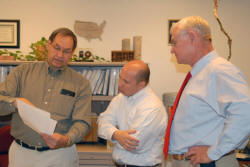 During his recent visit to Oklahoma, Chief Arlen Lancaster (center) gets an update on Oklahoma's watershed program by Watershed Specialist Larry Caldwell (left).