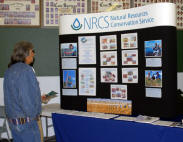Attendees visit NRCS booth