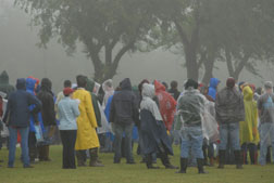 Contestants battle heavy rains.