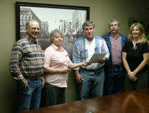 Bonnie Geer presents the deed to the land to the Muskogee County Conservation District. From left to Right; Ken Silver-MCCD Director, Bonnie Geer-Donor, Andy Qualls-MCCD Tech., Butch Garner-MCCD Director, Trish Kloeckler-MCCD District Secretary.