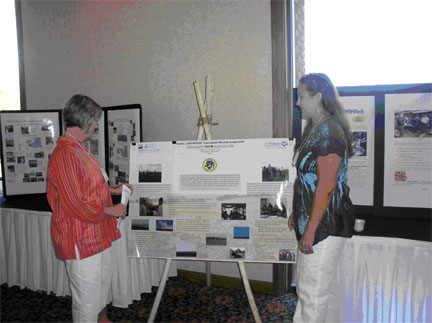 Oklahoma Tribal Resource Conservationist Melanie Oliver, discusses Osage grazing with conference attendee.