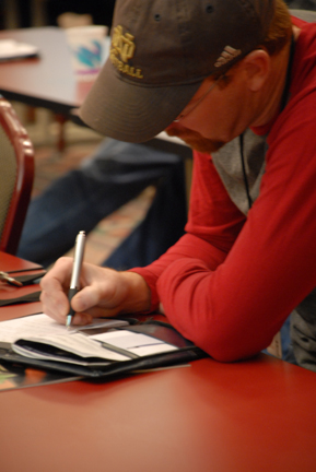A business owner takes notes during a session at the state no-till conference.