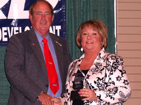 "Cross Timbers Board President, Kristi Coker, being presented the award for ""Outstanding Performance by a Council for 2008"" by Oklahoma's State Association of RC&D's President, James Aldridge."
