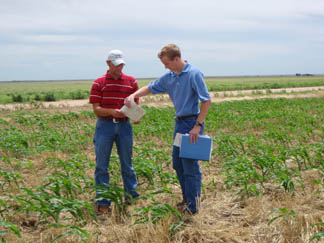 P.J. Martin, Student Trainee, (left) and Mike Van Wyk, Soil Conservationist (right) certify Residue management � Strip till.
