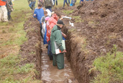 Contestants waded through nearly knee-deep water in some of the soil trenches.