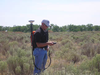 P.J. Martin, Student Trainee, measuring brush management practice with the GPS