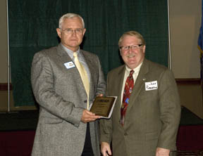 Cross Timbers Board Member, John Robertson, (right) presents NRCS Oklahoma State Conservationist Ron Hilliard with a plaque of appreciation for his support of Oklahoma RC&D Councils.