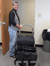 Lisa Shrader is all smiles as she picks up the donated computers she requested for Mannford and Oilton public schools.