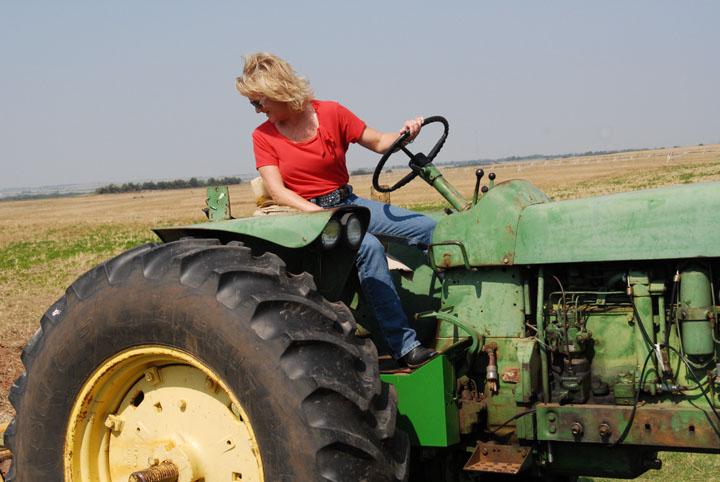 Reonna and Bryan do all the farming themselves. Reonna's father, Harold, taught her all aspects of the farming business, from keeping the books to driving the tractor.