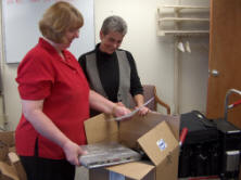 Lou Ann Walker (left), USDA�s Oklahoma Group Mgr, OCIO, presents Lisa Shrader, director of alternative education for Mannford and Oilton public schools, with 16 laptops and two high-end computers to use in their classrooms.